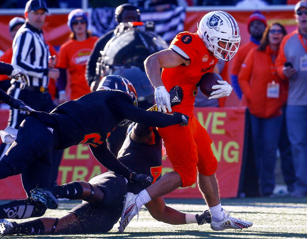 North receiver Andy Isabella of UMass (5) breaks free from South linebacker Gerri Green of Mississippi State (40) and safety Juan Thornhill of Virginia (21) during the second half of the Senior Bowl on Saturday, Jan. 26, 2019, in Mobile, Ala. (AP Photo/Butch Dill)