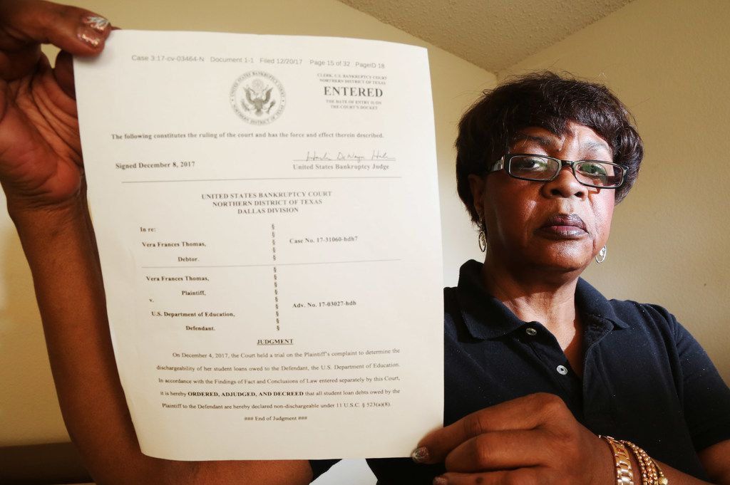 Vera Thomas holds the judgment that denied her petition to discharge her student loans when she filed for bankruptcy.