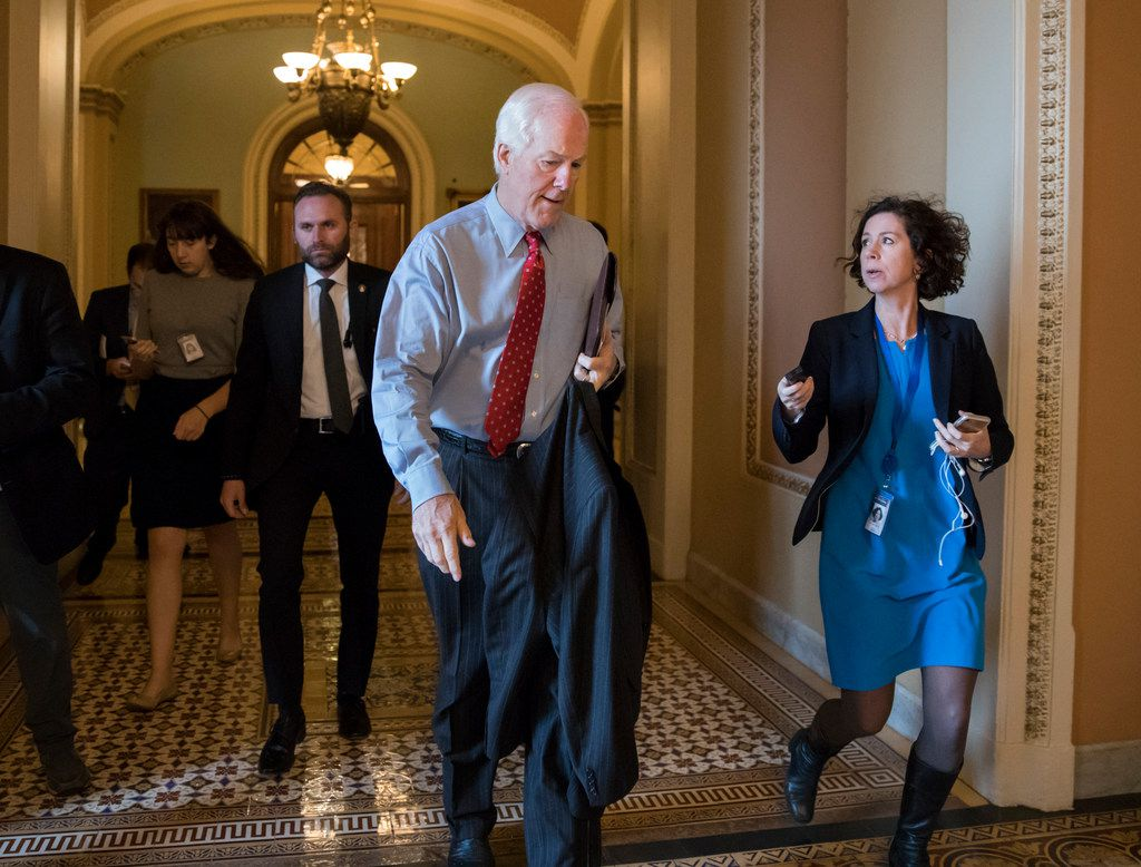 Senate Majority Whip John Cornyn, R-Texas, headed to meet with Senate Majority Leader Mitch McConnell, R-Ky., on the GOP effort to overhaul the tax code, on Capitol Hill in Washington on Dec. 1, 2017.