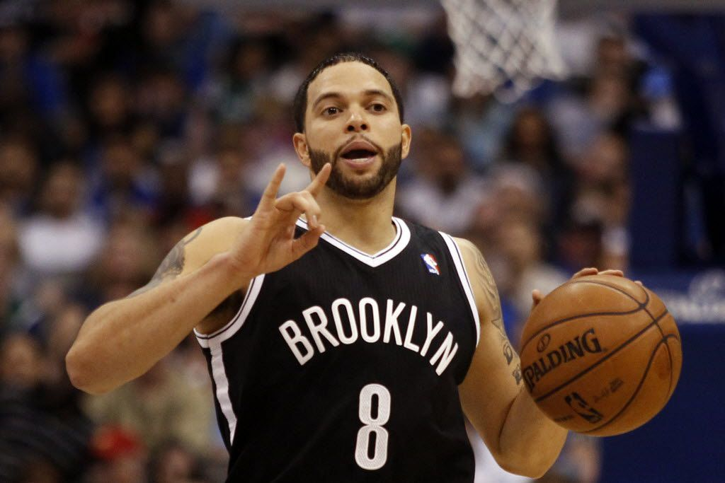 Brooklyn Nets' player Deron Williams communicates with his teammates during a game between the Dallas Mavericks and the Brooklyn Nets at American Airlines Center in Dallas on March 20, 2013. (Ian C. Bates/The Dallas Morning News)