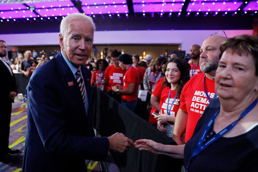 Democratic presidential candidate Joe Biden greets audience members after speaking at the Presidential Gun Sense Forum on Saturday in Des Moines, Iowa.