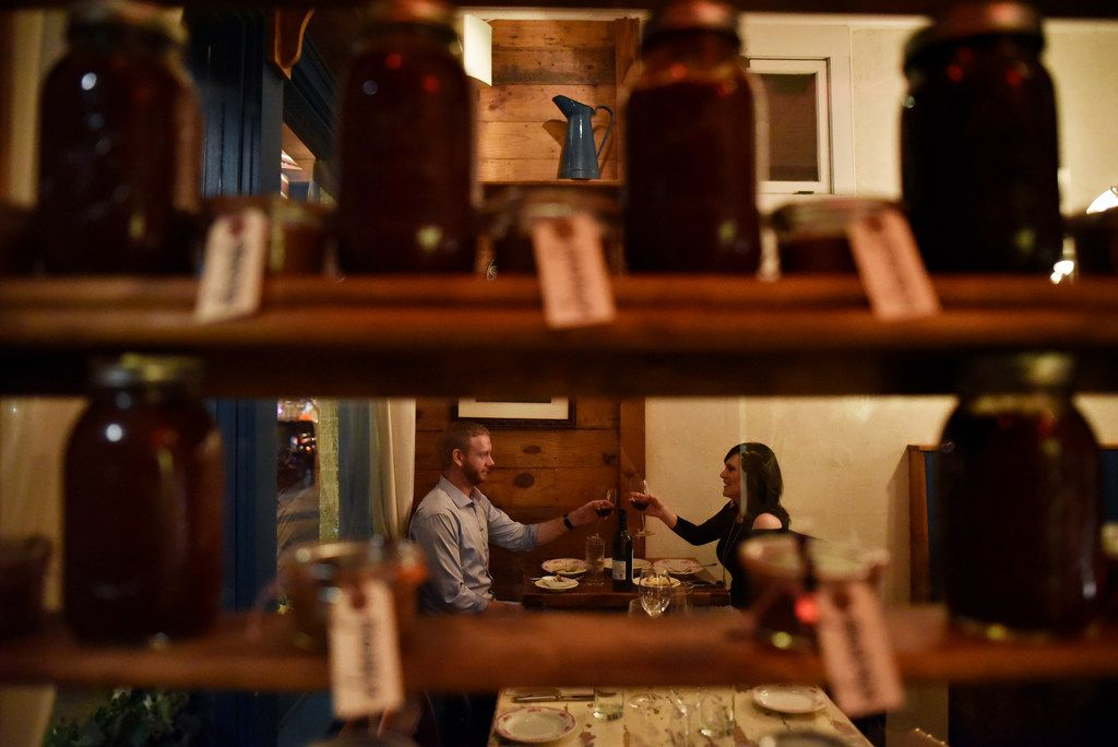 Jonathan James, 36, left, and Susan James, 37, both of Dallas, tap their glasses of wine together while having dinner at Lucia restaurant in the Bishop Arts district of Dallas, Saturday, Feb. 02, 2019. Ben Torres/Special Contributor