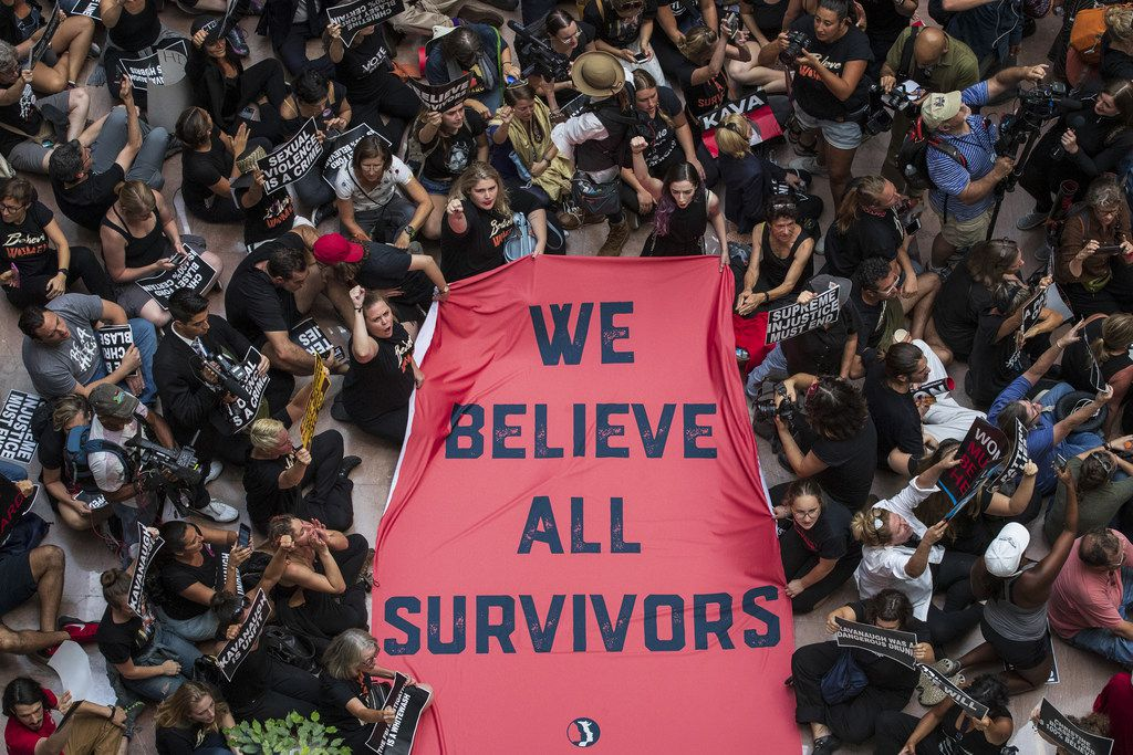 Protestors rally against Supreme Court nominee Judge Brett Kavanaugh in the atrium of the Hart Senate Office Building on Capitol Hill, October 4, 2018 in Washington, DC. Kavanaugh's confirmation process was halted for less than a week so that FBI investigators could look into allegations by Dr. Christine Blasey Ford, a California professor who has accused Kavanaugh of sexually assaulting her during a party in 1982 when they were high school students in suburban Maryland.