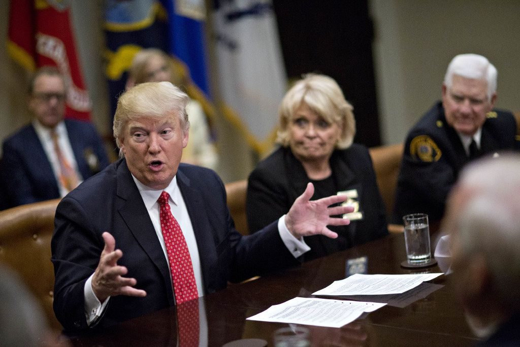 """President Donald Trump speaks as he meets with county sheriffs including Harold Eavenson, sheriff from Rockwall County (right) and Carolyn Welsh, sheriff from Chester County, Pennsylvania, during a listening session in the Roosevelt Room of the White House on February 7, 2017 in Washington, D.C. At that meeting, Eavenson complained about a Texas state senator, to which Trump replied he could help """"destroy his career."""" (Andrew Harrer/Getty Images)"""