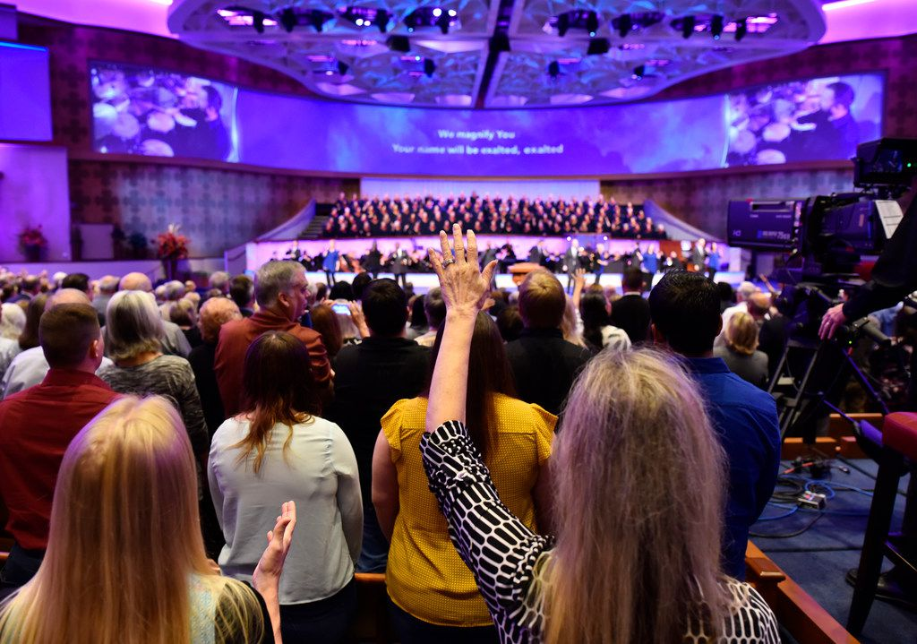 Parishioners raise their hands during a worship song at First Baptist Dallas on Oct. 22, 2017 in downtown Dallas.