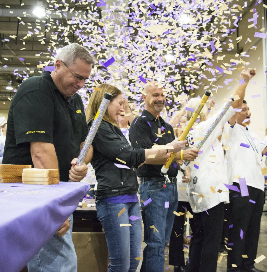 Confetti flies through the air after Which Wich's Guinness World Record Spreading Party broke the world record for the highest number of PB&J sandwiches made in one room in one hour with 39303 sandwiches.