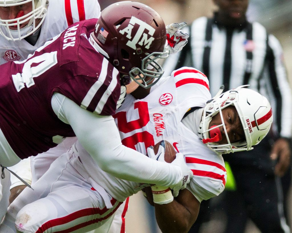 FILE - Texas A&M Aggies defensive lineman Daylon Mack (34) tackles Ole Miss Rebels running back D'Vaughn Pennamon (28) during the first quarter of a college football game between Texas A&M and Ole Miss on Saturday, November 9, 2018 at Kyle Field in College Station, Texas. (Ashley Landis/The Dallas Morning News)