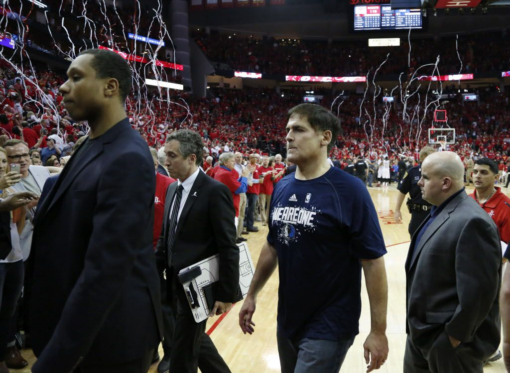 Dallas Mavericks owner Mark Cuban and team exit the court after losing to the Houston Rockets 116-108 in game 1 of the first round of the NBA playoffs at Toyota Center in Houston on Saturday, April 18, 2015. (Vernon Bryant/The Dallas Morning News)