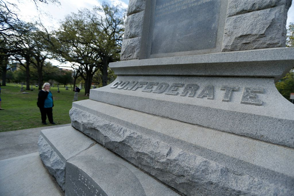 Georgeann Goldsborough of Houston looks at the Confederate War Memorial at Pioneer Park Cemetery in Dallas.