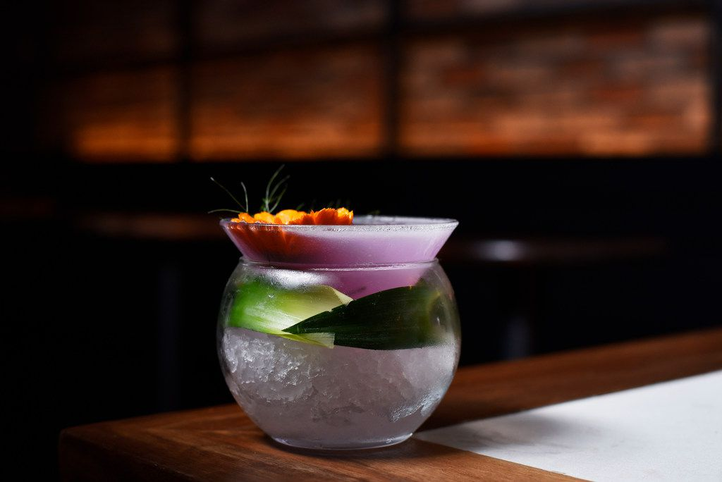 La Purple Drink, served with charanda, butterfly pea flower, lime juice and pineapple syrup at the newest speakeasy-type bar La Viuda Negra in Dallas, May 29, 2019