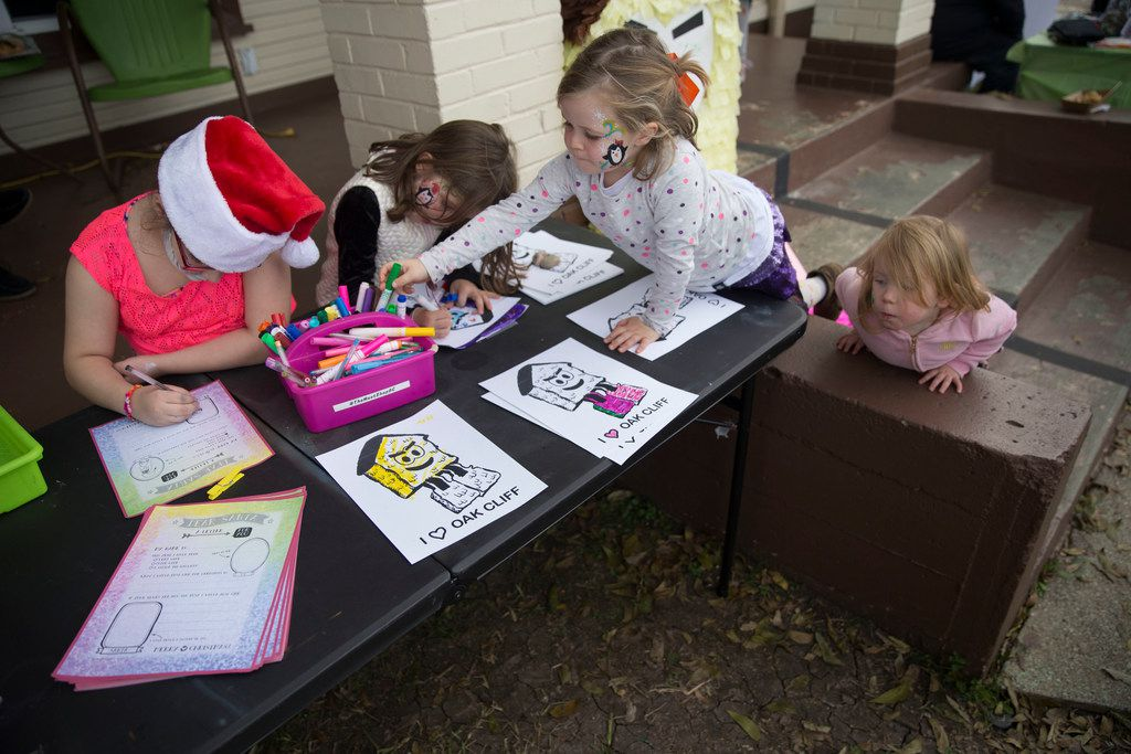 From left, Nova Ayala, 8, writes a letter to Santa Claus as sisters Lucy Shearer, 6, and Ruby Shearer, 5, color while their younger sister, Jolie Shearer, 2, watches.