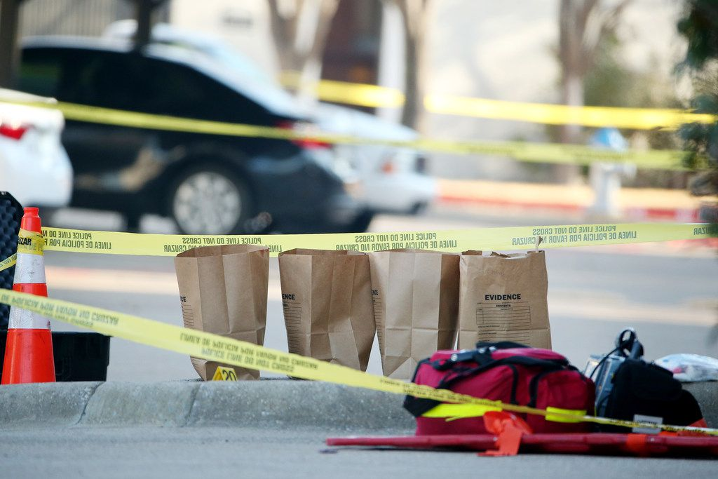 Evidence bags sit as authorities work near where they suspect Brandon McCall shot an officer the day before at the Breckinridge Point apartment complex in Richardson, Texas Thursday February 8, 2018.