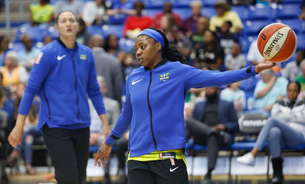 Dallas Wings guard Arike Ogunbowale (24) reaches for a rebound during team warm-ups prior to the start of their game against Las Vegas Aces. The two teams played their WNBA game at College Park Center in Arlington on August 3, 2019. (Steve Hamm/ Special Contributor)