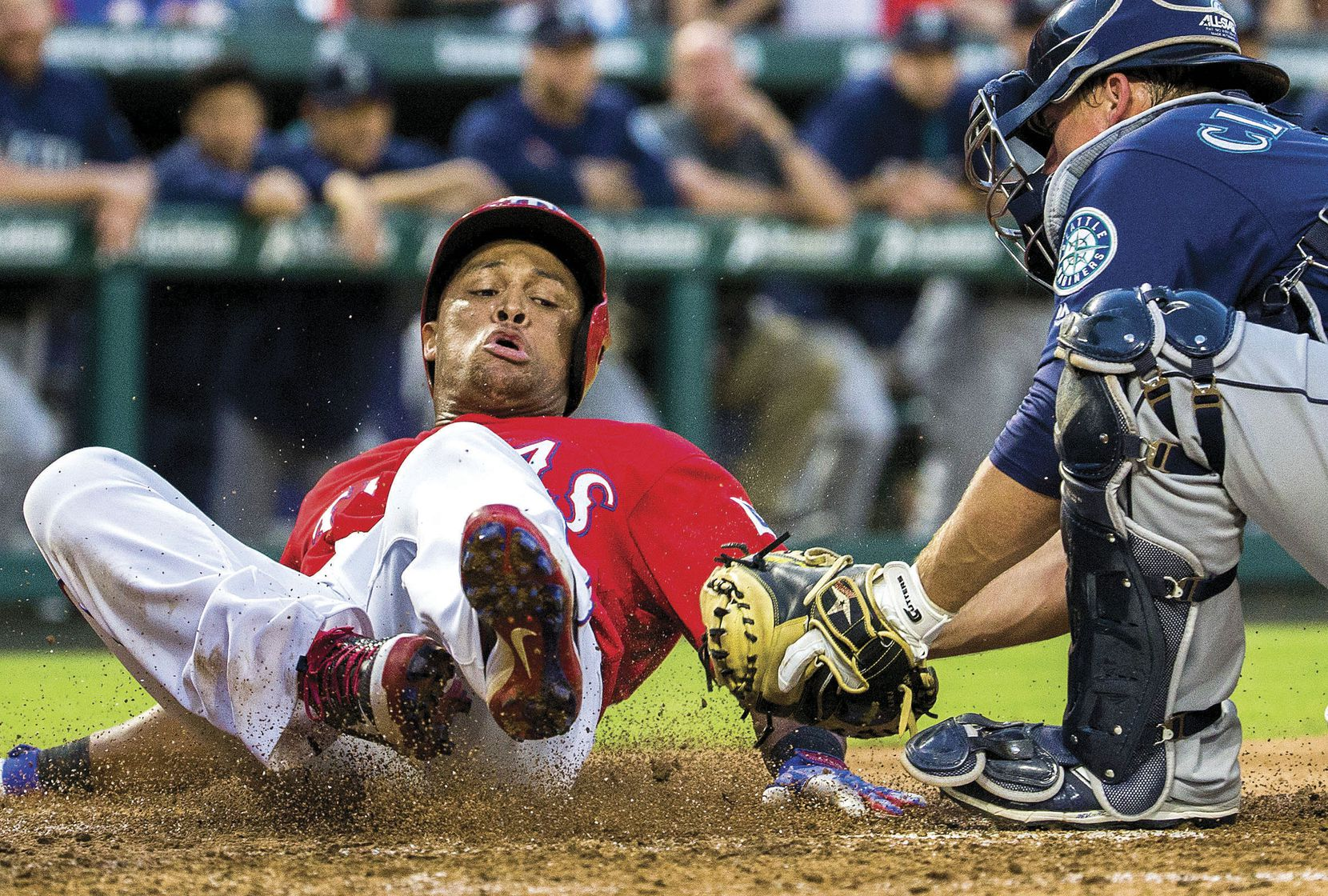 Texas Rangers third baseman Adrian Beltre was tagged out at home by Seattle Mariners catcher Steve Clevenger during the third inning of a game on June 3 at Globe Life Park in Arlington.