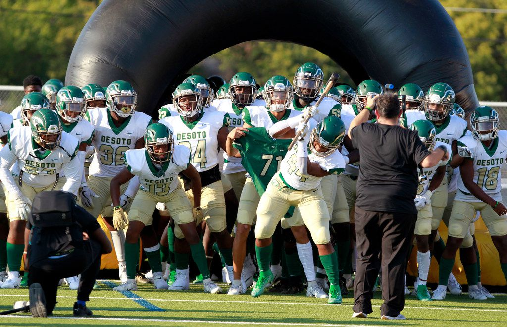 Desoto's DeMarcus Jackson (44) beats the turf with a sledge hammer, just prior to the team running onto the field before the first half of their high school football game, the Lone Star Sports Football Classic, against Bishop Dunne at Sprague Stadium in Dallas on Saturday, September 14, 2019. (John F. Rhodes / Special Contributor)