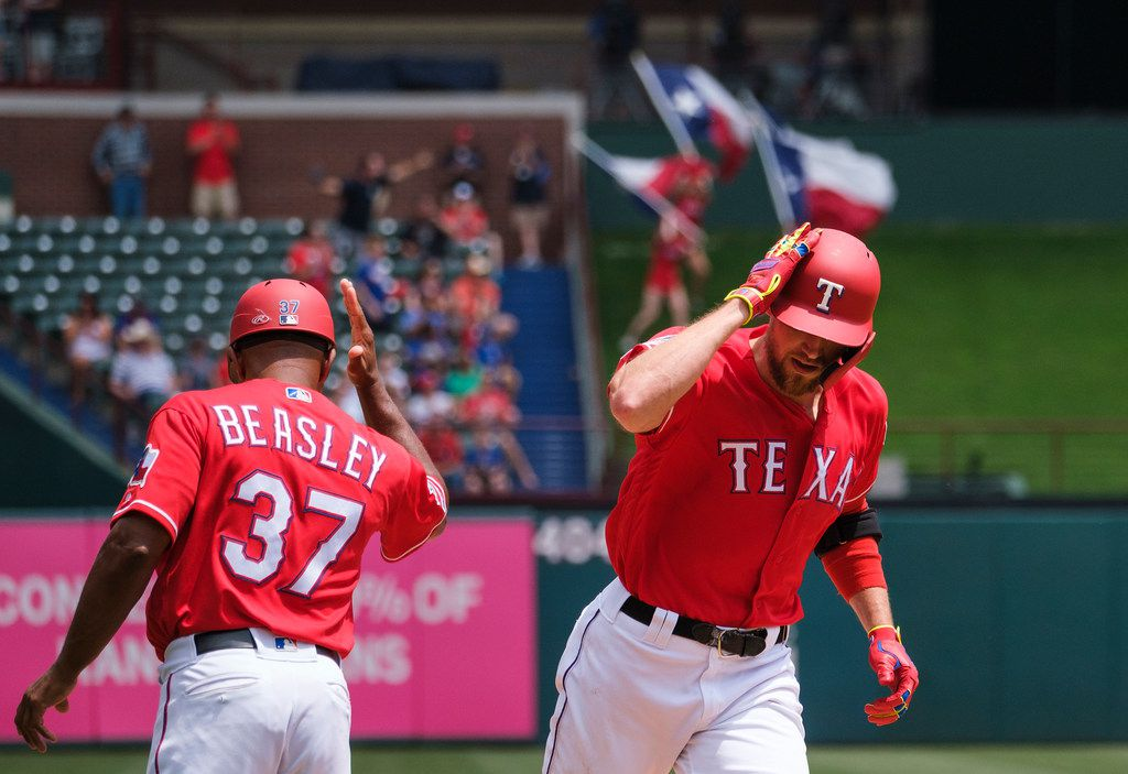 Texas Rangers designated hitter Hunter Pence celebrates with third base coach Tony Beasley as rounds the bases after hitting a solo home run off of Seattle Mariners starting pitcher Marco Gonzales during the sixth inning at Globe Life Park on Wednesday, May 22, 2019, in Arlington. (Smiley N. Pool/The Dallas Morning News)
