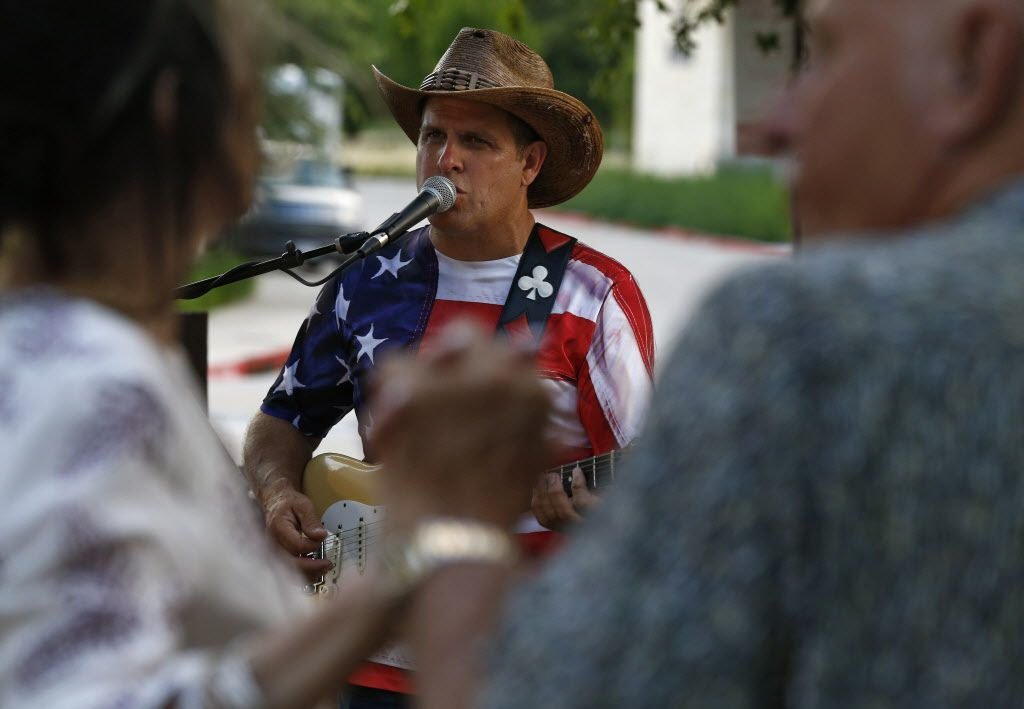 JD Monson plays music for dancing couples during the opening party for Hickory.