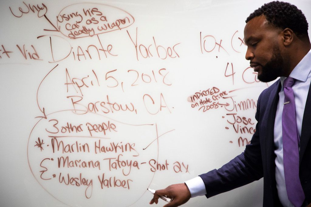 Civil rights attorney Lee Merritt writes on a whiteboard while talking strategy in the case of Diante Yarber at his downtown office on June 1 in Dallas. Yarber was an unarmed black man was shot 10 times by police in Barstow, California, in Apri