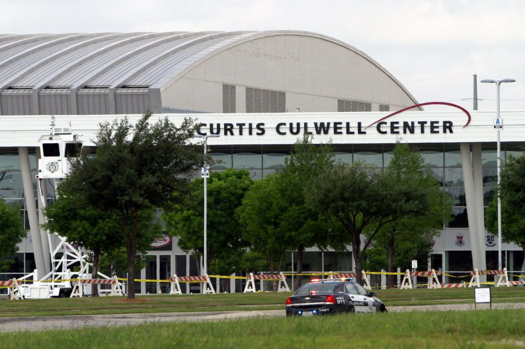 A Garland Police car is parked outside of the Curtis Culwell Center after a shooting occurred the day before May 4, 2015 in Garland.