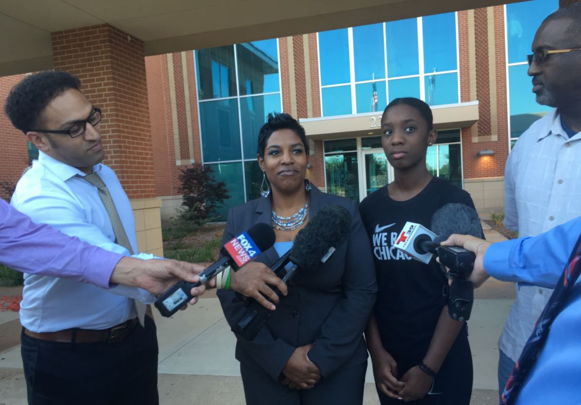 Dajerria Becton (right center) and her attorney, Kim T. Cole, at a news conference June 6 at McKinney Police Department headquarters. (Julieta Chiquillo/Staff)
