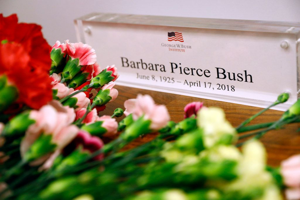 People left flowers in memory of former first lady Barbara Bush at a table for memory book signing inside the George W. Bush Presidential Center in University Park.