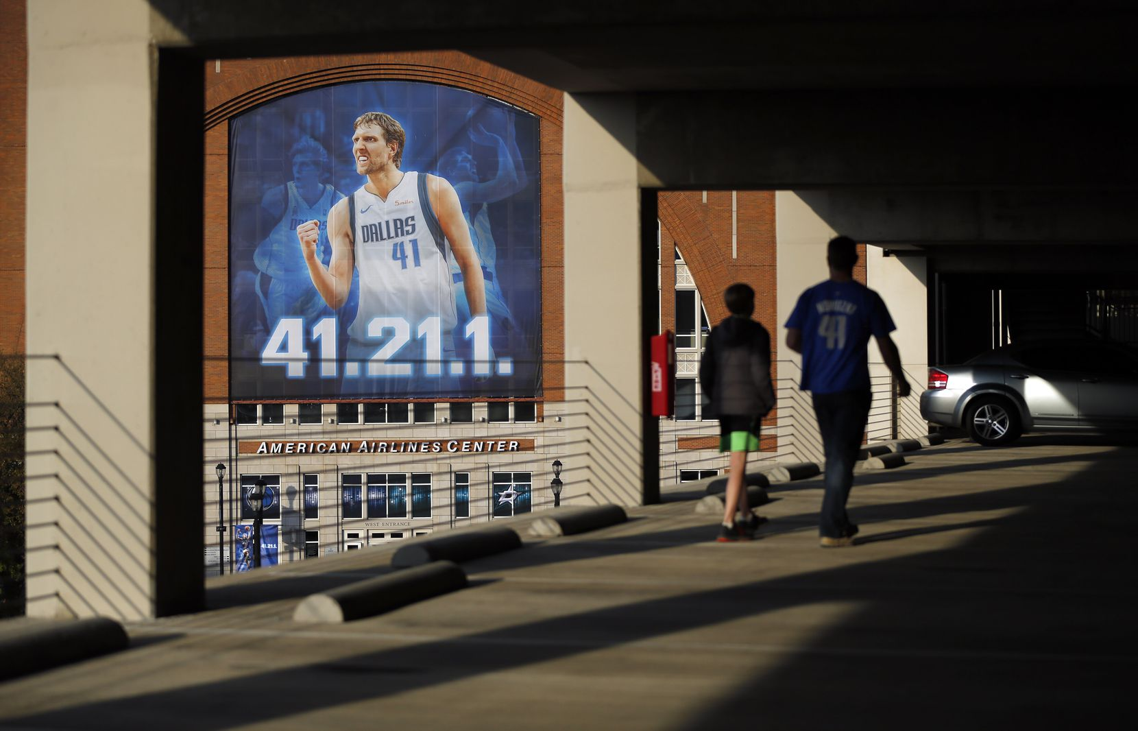 Dallas Mavericks fans Matt Pair of Waco and his 11-year-old son, Layton, viewed the All-Star forward Dirk Nowitzki plastered across the front of the American Airlines Center from the parking garage as they arrived for the game April 5, 2019. No. 41 has played 21 years with 1 team.