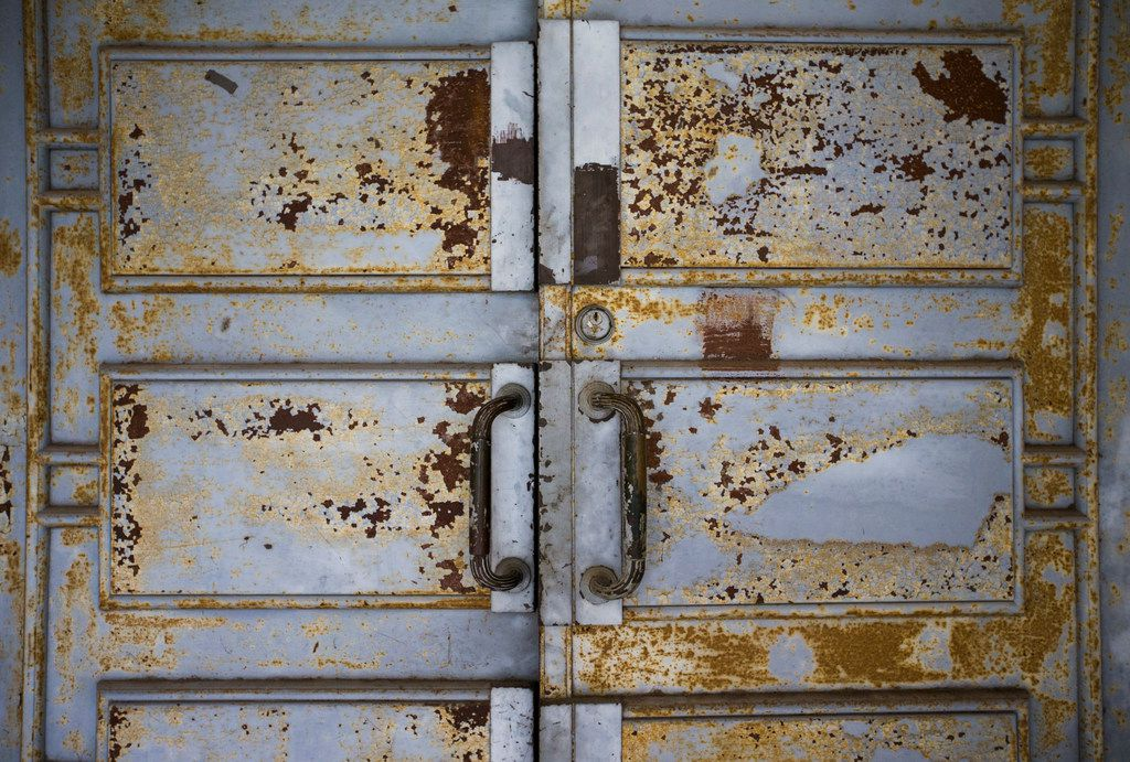Chipped paint on metal doors is shown outside the historic Hall of State building on March 1, 2019 at Fair Park in Dallas. The building, originally built in 1936 ahead of the Texas Centennial Exposition, will soon begin a restoration.