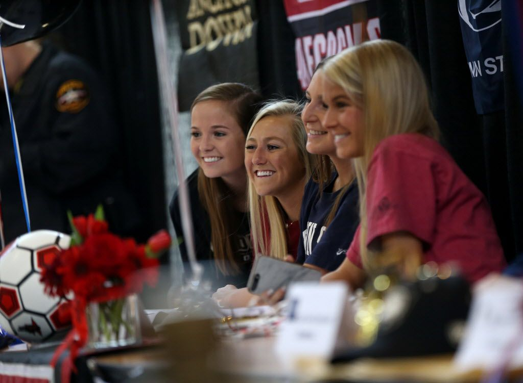 Highland Park soccer players (from left) Sarah O'Neal, Frances Ann Matise, Rachel Wasserman, and Sierra Jones pose for a photograph during Highland Park High School's National Signing Day ceremony at the school in Dallas on Wednesday, Feb. 7, 2018. (Rose Baca/The Dallas Morning News)