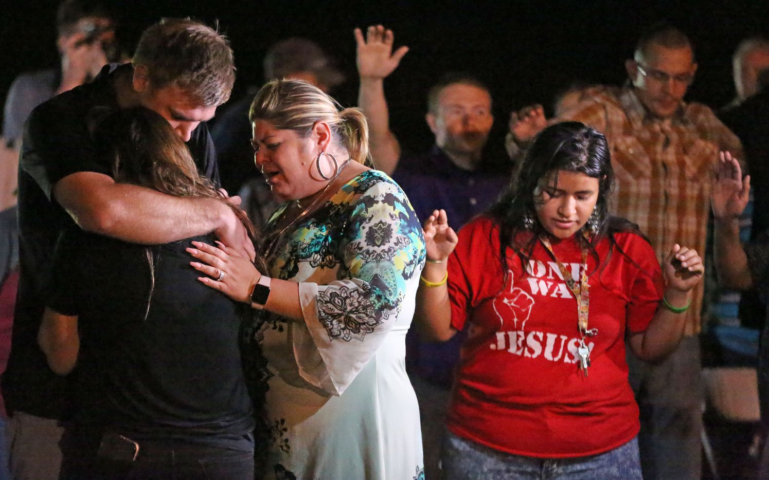 Emotions run high at a memorial service held at the baseball field in Sutherland Springs, Texas to honor those who were killed in Sunday's mass shooting, when a gunman opened fire at a Baptist church in the small town southeast of San Antonio. Photographed on Monday, November 6, 2017. (Louis DeLuca/The Dallas Morning News)