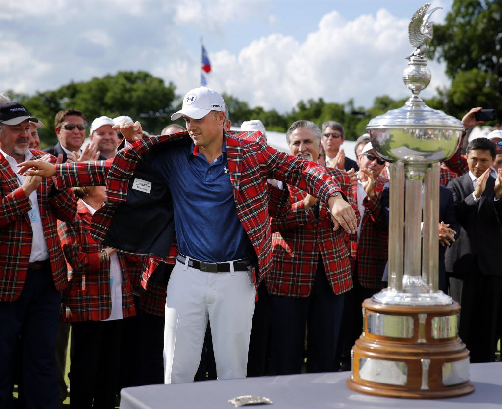 Jordan Spieth dons the checkered jacket after winning the Dean and Deluca Invitational at the Colonial Country Club in Fort Worth, Sunday, May 29, 2016. (Tom Fox/The Dallas Morning News)