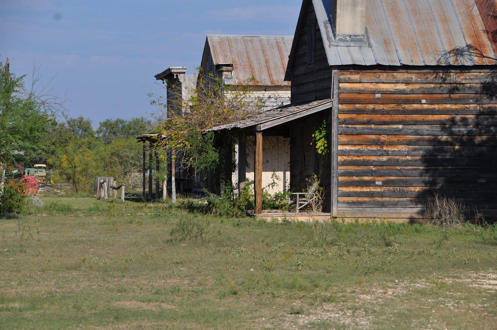 Deteriorating buildings at the Alamo Village site.