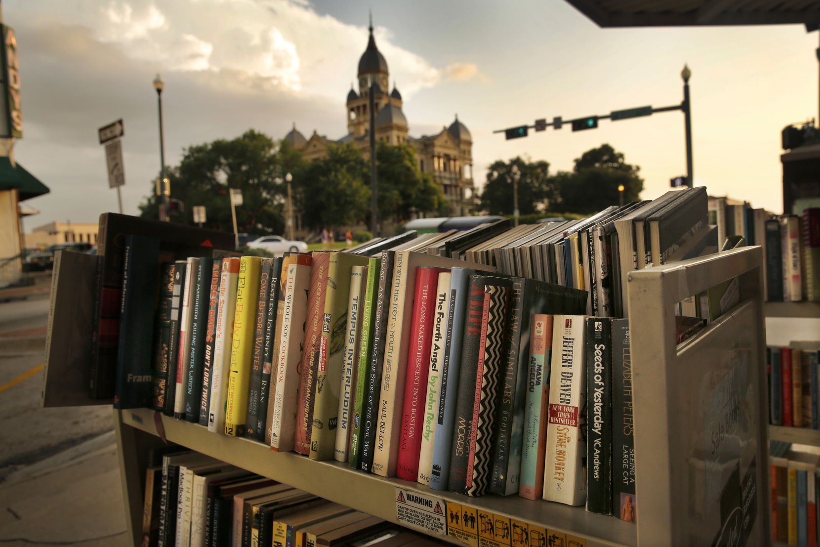 Books are for sale on the sidewalk outside Recycled Books at 200 N Locust  in downtown Denton.