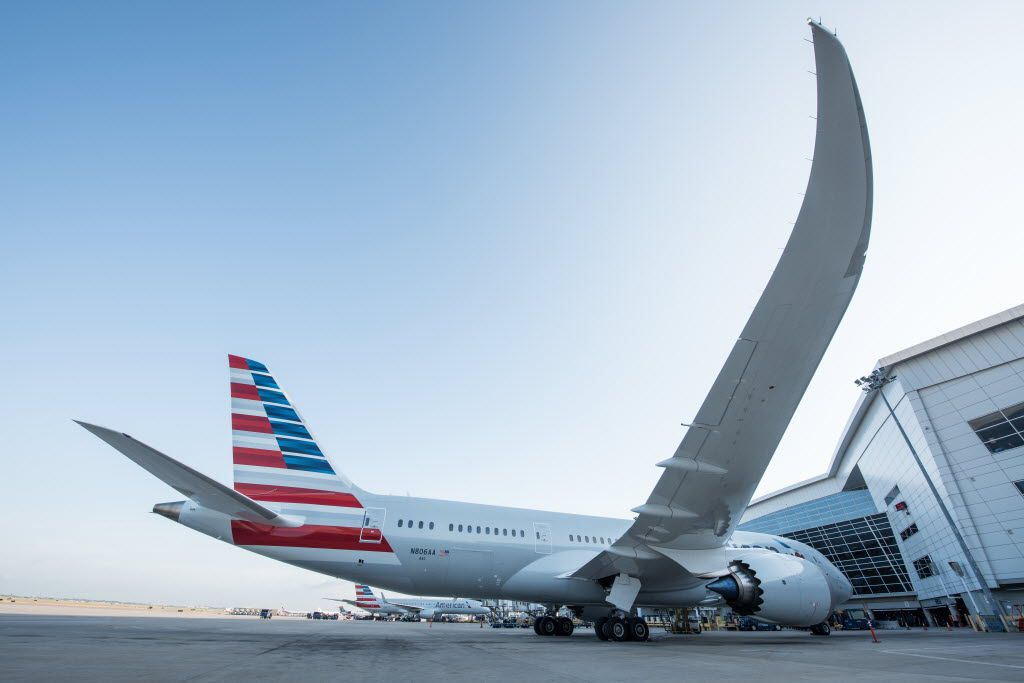 An American Airlines jet sits at a loading gate at Dallas/Fort Worth International Airport.