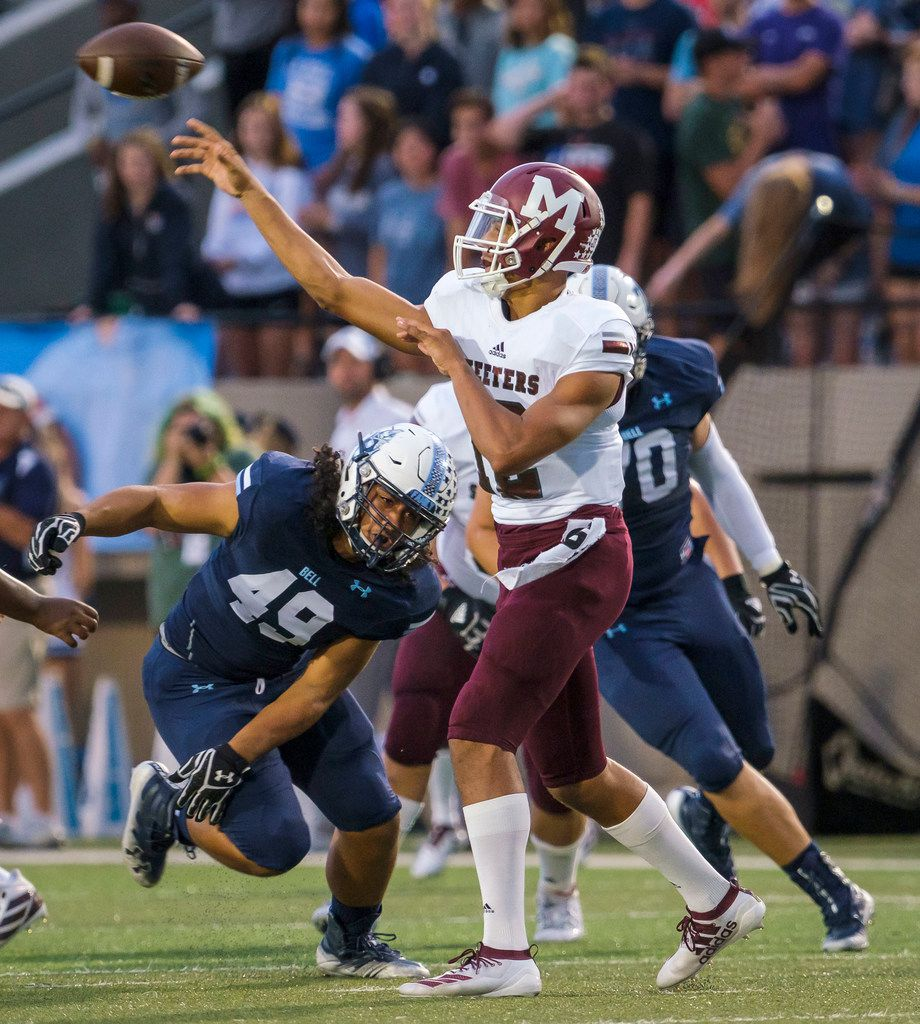 Mesquite quarterback Dylan Hillard-McGill (12) throws a pass under pressure from L.D. Bell defensive lineman Peter Lilomaiava (49) during the first half of a high school football game on Thursday, Sept. 19, 2019, in Bedford, Texas. (Smiley N. Pool/The Dallas Morning News)