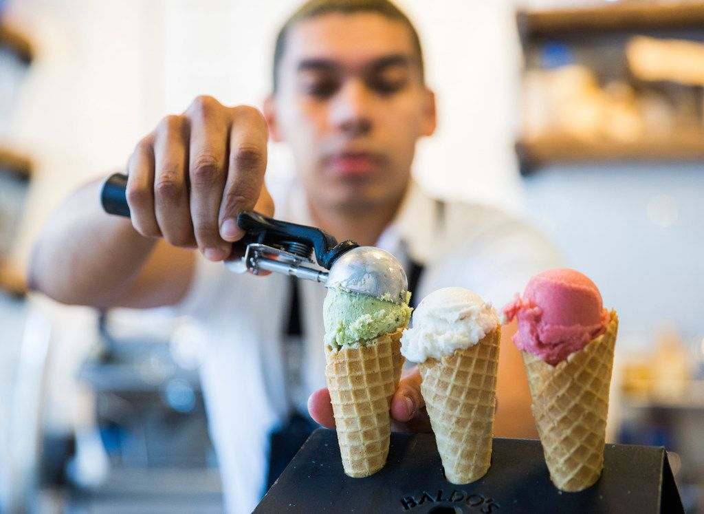 Chef Aldo Sandoval serves a flight of ice creams at Baldo's Ice Cream and Coffee on May 15, 2019.