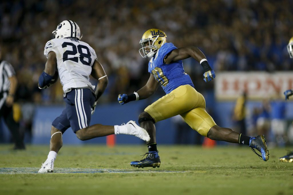 UCLA linebacker Myles Jack (right) runs down BYU running back Adam Hine during an NCAA college football game, Saturday, Sept. 19, 2015, in Pasadena, Calif. UCLA won 24-23. (AP Photo/Danny Moloshok)