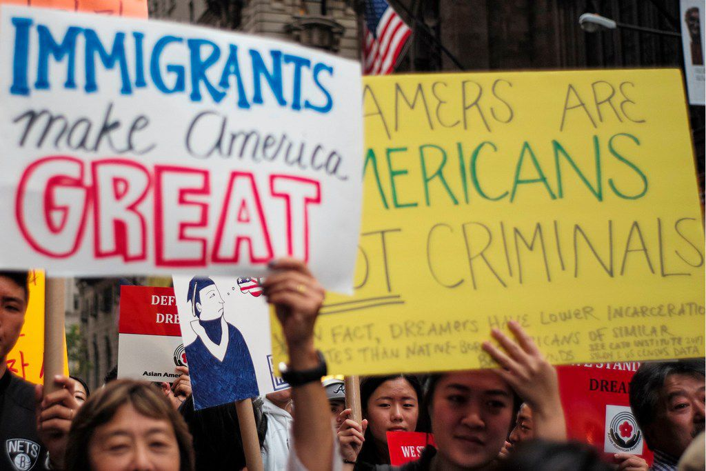 Protesters hold up signs during a demonstration against U.S. President Donald Trump during a rally in support of the Deferred Action for Childhood Arrivals (DACA), also known as the Dream Act, near Trump Tower in New York on Oct. 5, 2017.