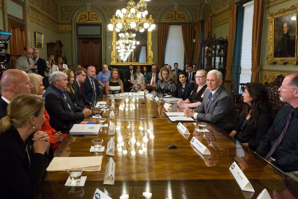 A Fort Worth couple -- Robert and Amy Dean, pictured at far left end of the table -- were among the families to take part in a health care listening session with Vice President Mike Pence on Monday, June 26, 2017. Robert and Amy Dean hope the GOP's health care overhaul will result in more affordable, better coverage.