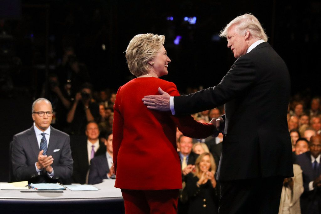 The faux friendliness at the outset of the Sept. 26 debate was only the first of many falsehoods voters witnessed from the stag when Donald Trump and Hillary Clinton met at Hofstra University. But social scientists and behavior psychologists say that once voters pick a side to root for, they tend to overlook the flaws.