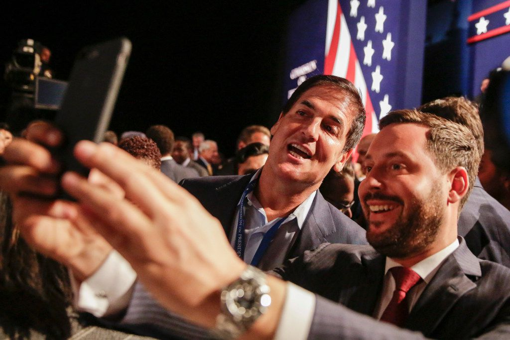 Businessman Mark Cuban and Michael Kives pose for a selfie before the presidential debate between Democratic presidential nominee Hillary Clinton and Republican presidential nominee Donald Trump at Hofstra University in Hempstead, N.Y., Monday, Sept. 26, 2016. (AP Photo/David Goldman)