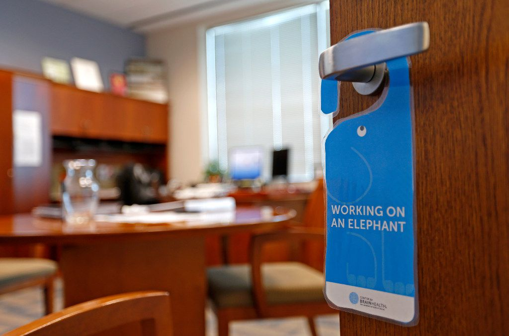 A placard hangs on a door handle of Assistant Chief Tammie Hughes' office at the Dallas Police Department headquarters in Dallas, Wednesday, July 19, 2017. Assistant Chief Hughes got the placard earlier this year, after completing a program that teaches officers how to manage stress and their workload. (Jae S. Lee/The Dallas Morning News)