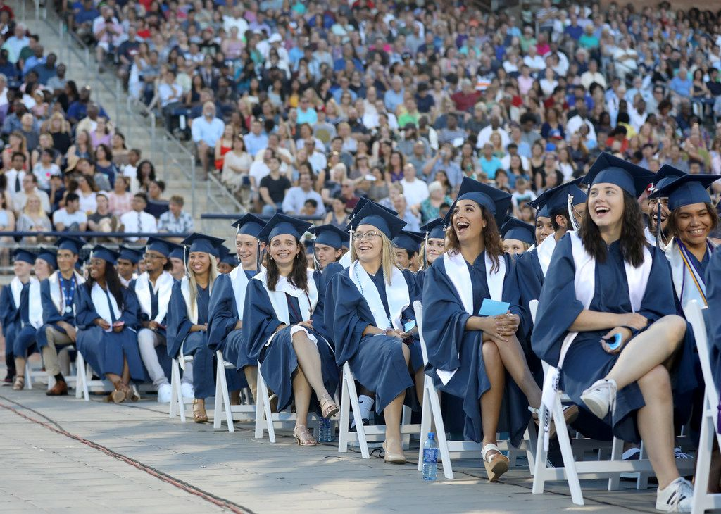 Graduates laugh at images on a big screen during the Allen High School graduation at Eagle Stadium in Allen, Texas, Friday evening, June 1, 2018. (Anja Schlein/Special Contributor)