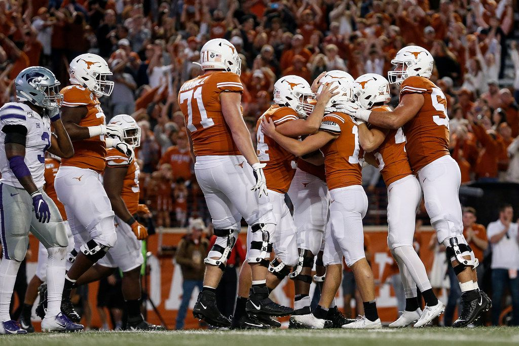 The Texas Longhorns congratulate Cameron Dicker #17 after a game-winning field goal against the Kansas State Wildcats at Darrell K Royal-Texas Memorial Stadium on November 9, 2019 in Austin, Texas.