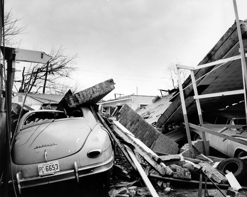Vehicles were crushed under a carport in Dallas after the tornado passed through Dallas in 1957.