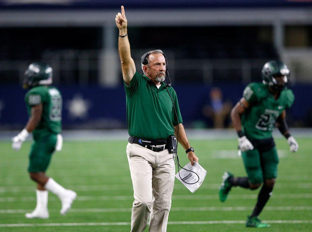 Kennedale's head coach Richard Barrett signals going for one on the point after touchdown attempt in a game against Stephenville during the first half of play in a Class 4A Division I state semifinal at AT&T Stadium in Arlington, on Friday, December 15, 2017. (Vernon Bryant/The Dallas Morning News)