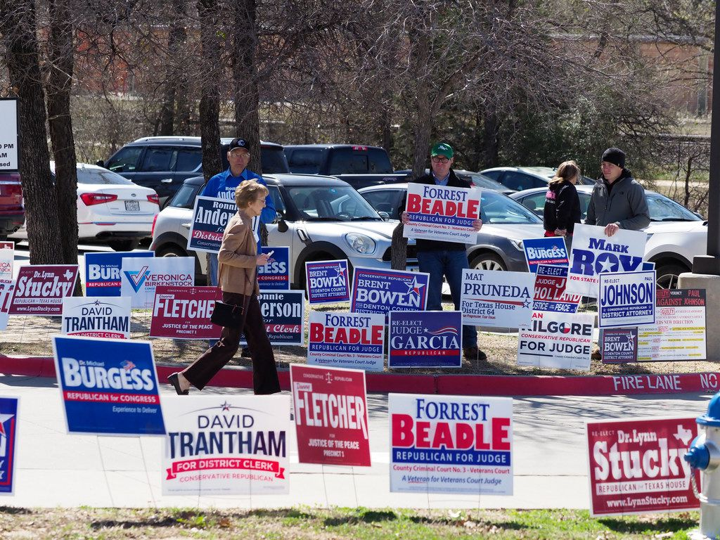 A group of candidate faithfuls try to persuade voters to cast their vote for their nominee at City Hall in Corinth.