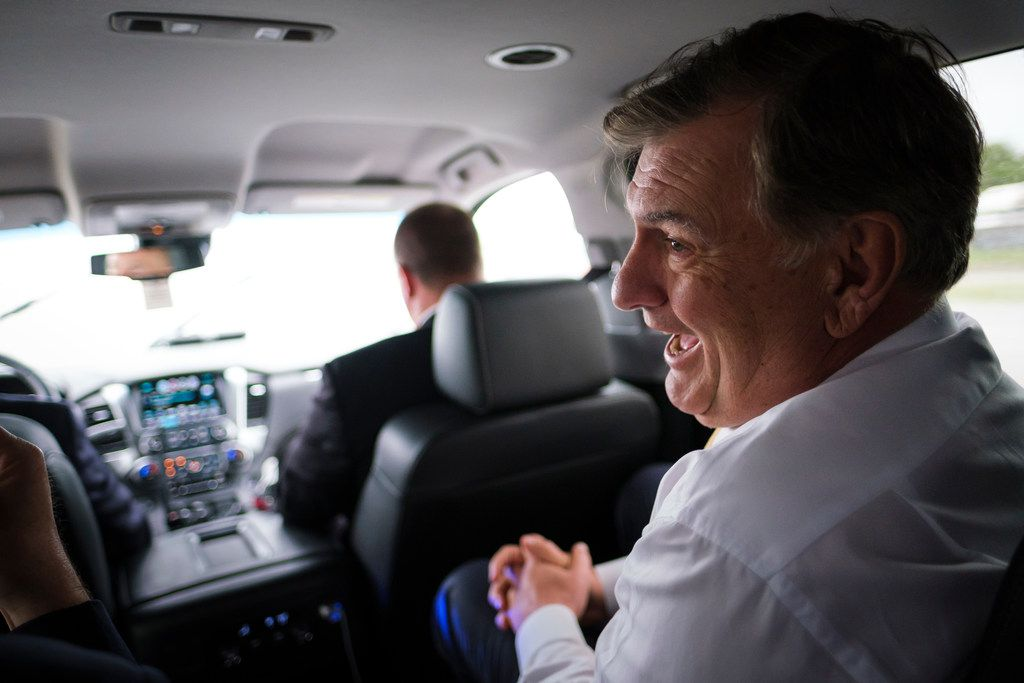 Dallas Mayor Mike Rawlings laughs while riding from Dallas City Hall to an offsite City Council meeting at the Kleberg-Rylie Recreation Center  on May 8, 2019. (Smiley N. Pool/The Dallas Morning News)