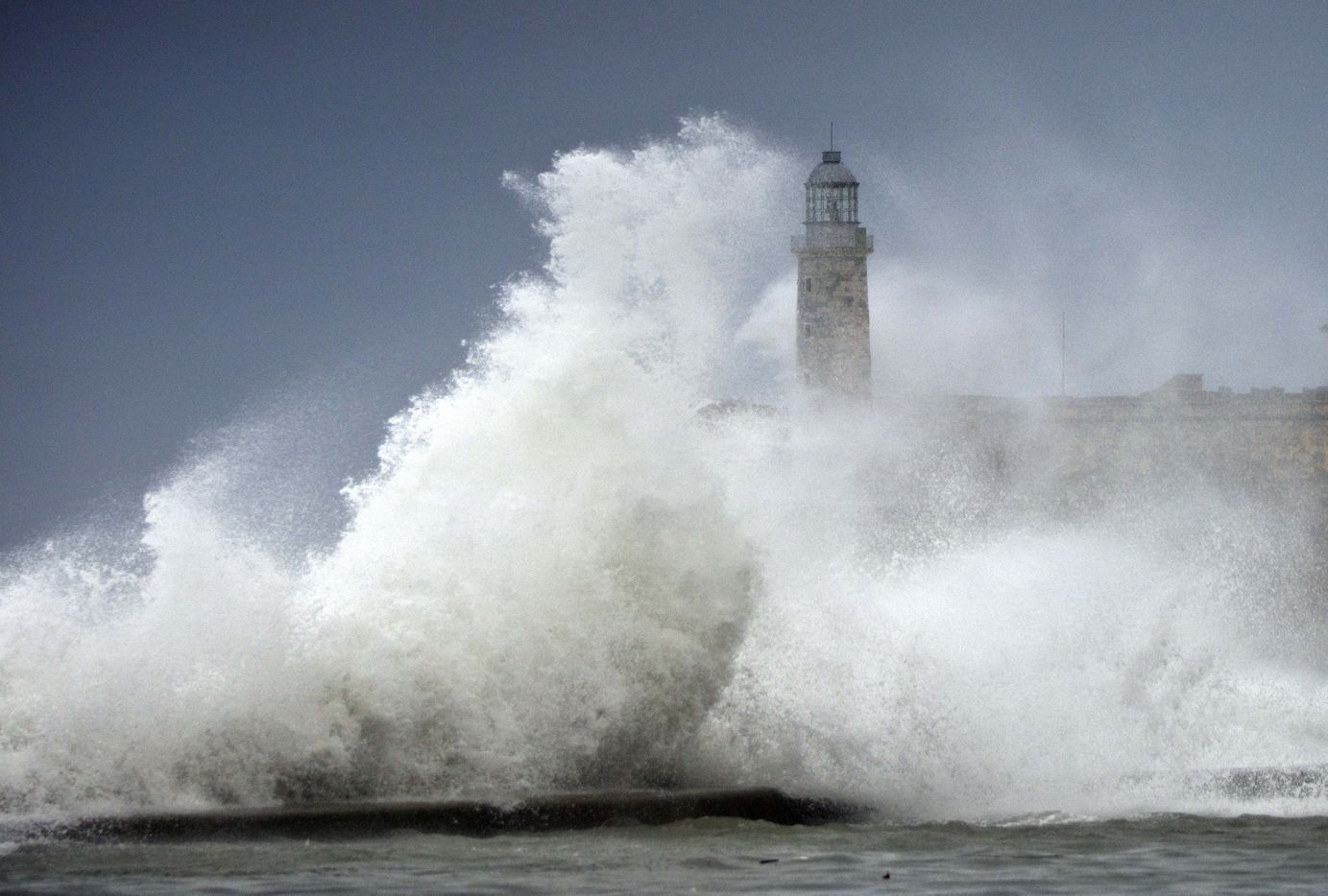 Waves crash into El Morro after the passing of Hurricane Irma, in Havana, Cuba, Sunday, Sept. 10, 2017. The powerful storm ripped roofs off houses, collapsed buildings and flooded hundreds of miles of coastline after cutting a trail of destruction across the Caribbean.There were no immediate reports of deaths in Cuba, a country that prides itself on its disaster preparedness, but authorities were trying to restore power and clear roads.