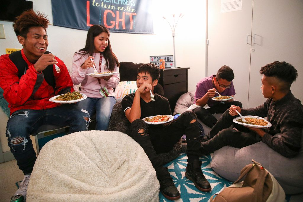 Students ate fried rice and lahpet thoke, a fermented tea leaf salad, during a May 21 meeting of the Chin Club at Lewisville High School's Killough campus for ninth- and 10th-graders.