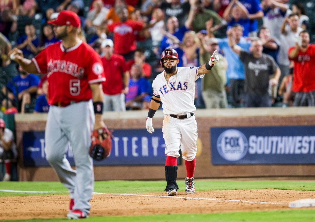 Texas Rangers second baseman Rougned Odor (12) disputes a call that he was out at first during the eighth inning of an MLB game between the Texas Rangers and the Los Angeles Angels on Thursday, August 16, 2018 at Globe Life Park in Arlington. The call was overturned and called safe. (Ashley Landis/The Dallas Morning News)